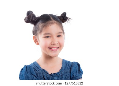 Closeup shot of young asian girl smiling over white background