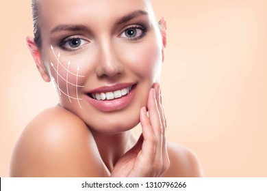 Closeup shot of young beautiful woman face portrait with healthy skin. Pretty girl smiling to you