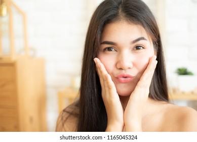 Close-up shot of young girl puckering lips at the camera