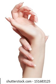 closeup shot of young woman's healthy hands with manicure on white