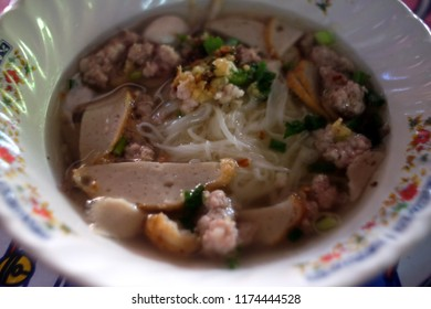 Close-up shots of noodles in a bowl of Chinese style pork noodle soup. selective focus.