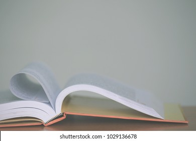 Close-up shots of open books lying on the floor selective focus and shallow depth of field