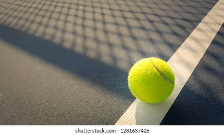 Close-up shots of tennis balls on a shadowy background field