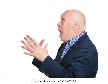 Closeup side view portrait, headshot senior mature man looking shocked surprised in disbelief hands in air, open mouth eyes, isolated white background. Positive human emotion facial expression feeling