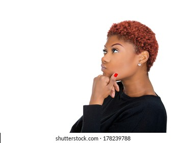 Closeup side view portrait of young business woman thinking, daydreaming deeply about something chin on hand looking up, isolated on white background. Human emotion facial expression feeling, reaction