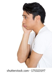 Closeup side view profile portrait of sad bothered stressed serious young man chin on hand really depressed about something, isolated white background. Negative emotion facial expression feeling