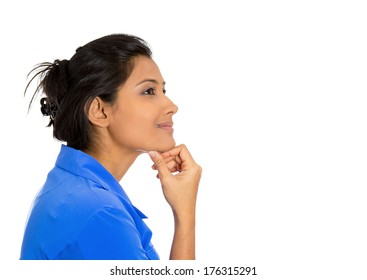 Closeup side view profile portrait of young pretty smiling young woman, student, worker, daydreaming, isolated on white background. Positive emotion facial expressions feelings attitude perception.