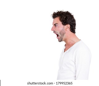 Closeup side view profile portrait of angry upset young man, worker, employee, business man with wide open mouth, yelling isolated on white background. Negative emotions, facial expressions, reaction
