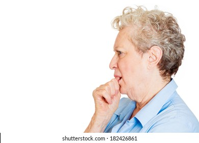 Closeup, side view profile portrait of senior mature woman with finger in mouth, sucking thumb, biting fingernail in stress, isolated on white background. Negative emotion, facial expression, feelings