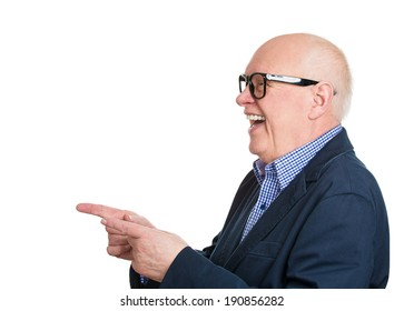 Closeup side view profile portrait senior man in glasses, laughing, pointing with finger at someone, isolated white background. Positive human face expressions, emotions, feelings, attitude, approach