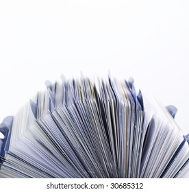 Closeup side view of a rolodex, isolated against a white background