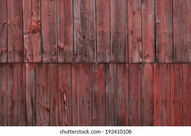 Closeup side of a weathered red barn, Stowe, Vermont, USA