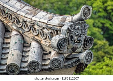 Closeup Side-View of Oni Ogre Face Decoration of Gable Eave Corner of Historic Buddhist Temple (Nara, Japan)