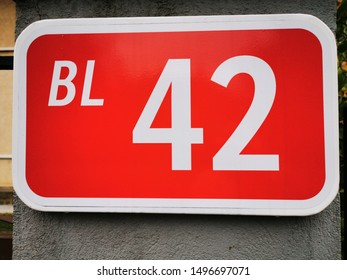 closeup of sign for block numeral forty two number 42 in vivid red and white lettering text