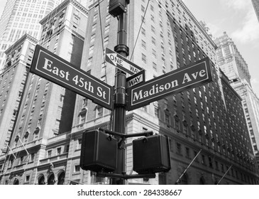 A closeup to signs for East 45th and Madison Avenue in New York City