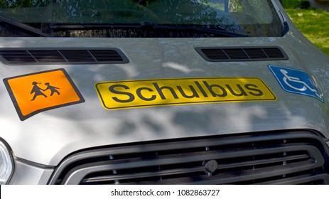 Close-up of signs on a school bus for handicapped children in Germany