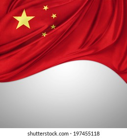 Closeup of silky Chinese flag on plain background