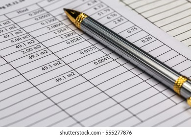 Close-up of silver ballpoint pen over rent document