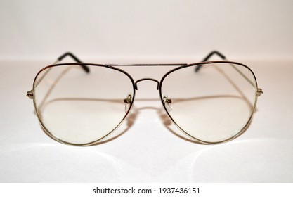 Closeup of Silver and Black Aviator Style Glasses Against White Background