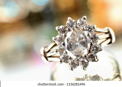 Close-up of silver ring with artificial stone - jewelery, warm color balance