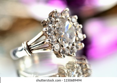 Close-up of silver ring with diamonds - jewelery, warm color balance
