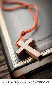 Closeup of simple wooden Christian cross necklace