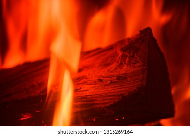 Close-up of single log in red fire flames