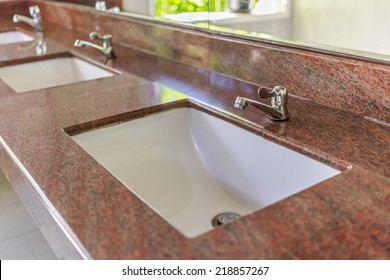 Closeup sinks in the toilet.
