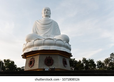 Closeup of sitting Buddha statue in white marble in Khanh Hoa Province, Vietnam