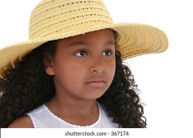 Close-up of a Six Year Old Girl In Yellow Hat Over White.