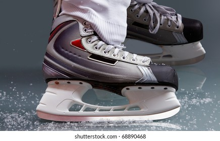 Close-up of skates on player feet during ice hockey