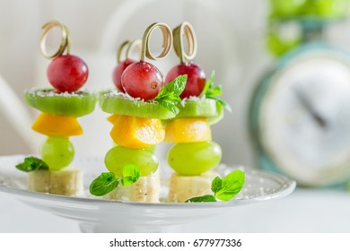 Closeup of skewers with fruits and mint