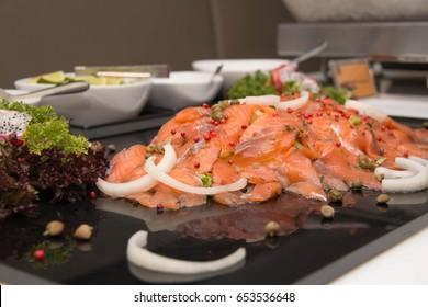 Close-up of slice piece smoked salmon on plate