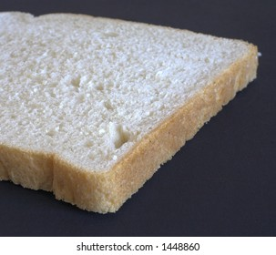 Closeup to a slice of white bread