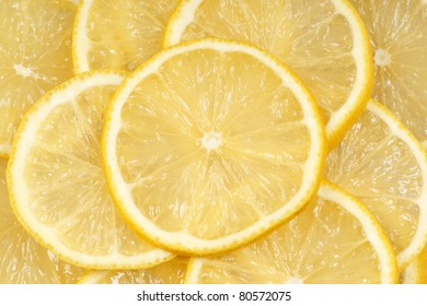 Closeup of slices of fresh lemon for an organic background.