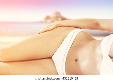 closeup of slim woman body and white bikini
