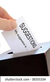 Close-up of a slip being placed in a suggestion box over a white background