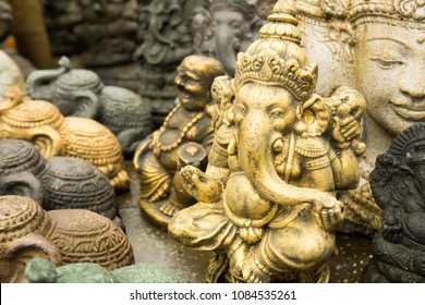 Closeup of a small golden coloured statue of Ganesha in Bali, Indonesia