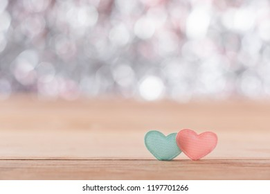 Close-up of small heart sign on wooden table, beautiful boken background, soft focus
