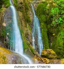 closeup small mountain brook rushing over a stones