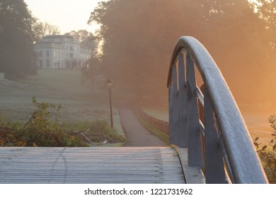 Closeup from a small pedestrian bridge covered with frost on a misty morning in November. Location: Park Sonsbeek Arnhem, Netherlands.