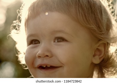 3accb4598c3 Closeup of small pretty happy boy with blonde curly hair smiling sunny day  outdoor on natural