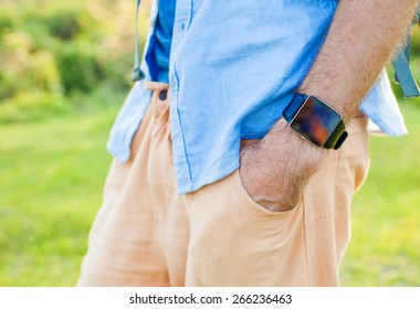 Closeup of a smart watch with empty screen on a man's wrist. Template for smartwatch app design