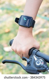 Close-up smart watch on arm women to ride a bicycle