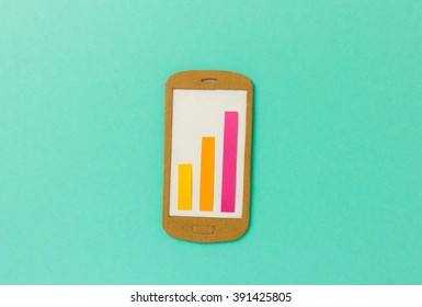 Closeup of smartphone illustration with colorful bars chart - image for business app, market development or growth