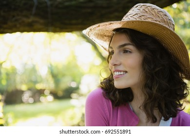 Close-up of smiling beautiful woman in garden