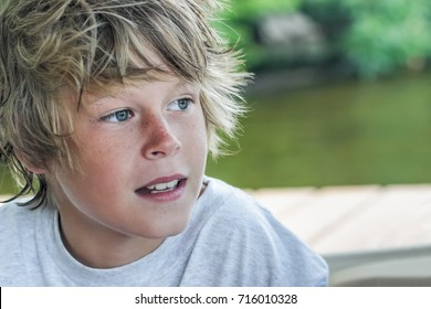 Closeup of a smiling boy sitting on a boat
