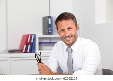 Closeup of smiling businessman in the office