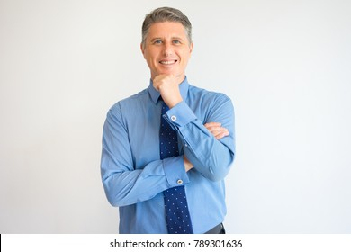 Closeup of Smiling Executive with Hand on Chin