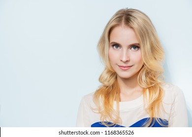 Close-up of smiling fair haired young elegant girl. Beauty concept. Good mood.